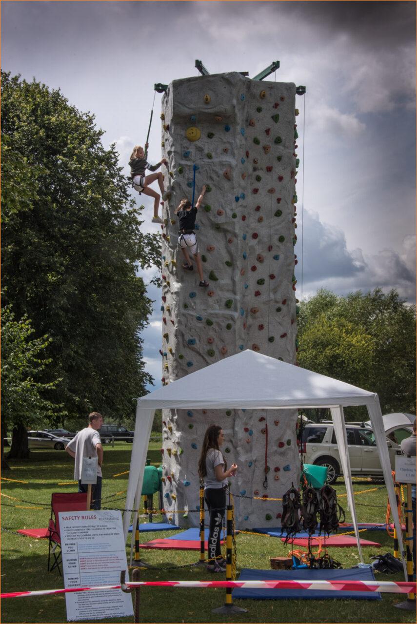Girls using a climbing wall at Big Meadow