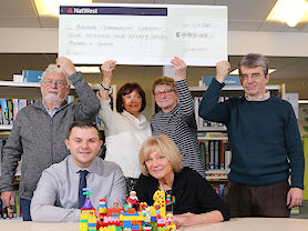 Presentation of cheque to the Library from Warners Budgens
