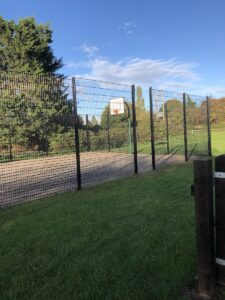 Fence around basketball court in Broom